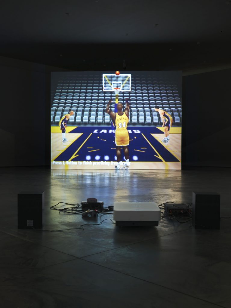 Cory Arcangel, still from Self Playing Nintendo 64 NBA Courtside 2, 2011, hacked Nintendo 64 video game controller, Nintendo 64 game console, NBA Courtside 2, game cartridge, and video. Courtesy of the artist.